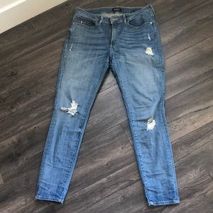 Distressed buffalo jeans